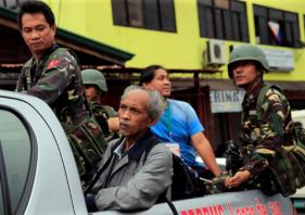 Philippine troops evict raiders; hostages freed