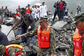 Over 100 people feared buried by southwest China landslide