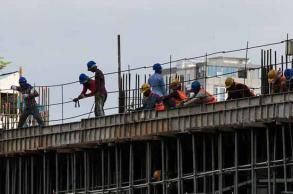Cambodian construction workers denied paid leave