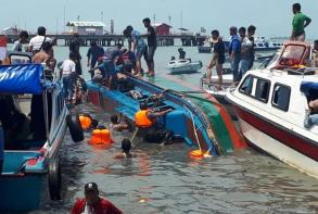 Indonesia speed boat capsizes, killing at least 10 - police