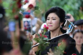 Yingluck: Government tries to influence court