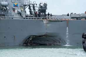 Damaged US warship arrives in Singapore, 10 missing