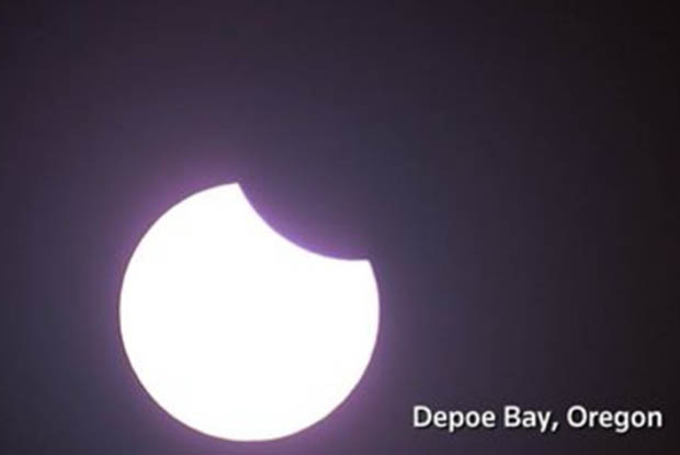 Solar eclipse begins over west coast