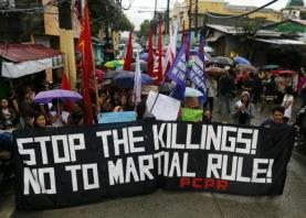 Philippine opposition presses Duterte to stop killings