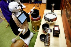Robot-for-hire programmed to perform Buddhist funeral rites