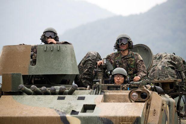 South Korean soldiers travel in an armored vehicle along a road near the border in Paju South Korea on Wednesday