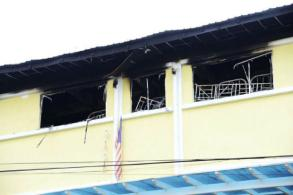 Youths charged with murder after Malaysian school fire
