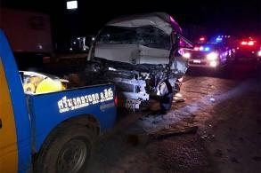 Van rear-ends truck parked on road after earlier crash