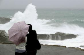 Powerful typhoon drenches Japan as voters trudge to polls