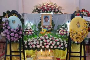 King honours royal-cremation volunteer