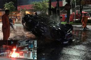 Driver pulled to safety as crashed car erupts in flames
