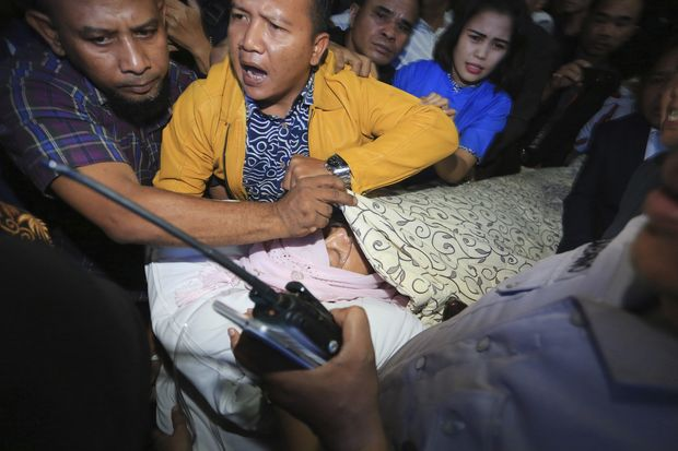 Disbelief as 'most wanted' Indonesia politician hospitalised