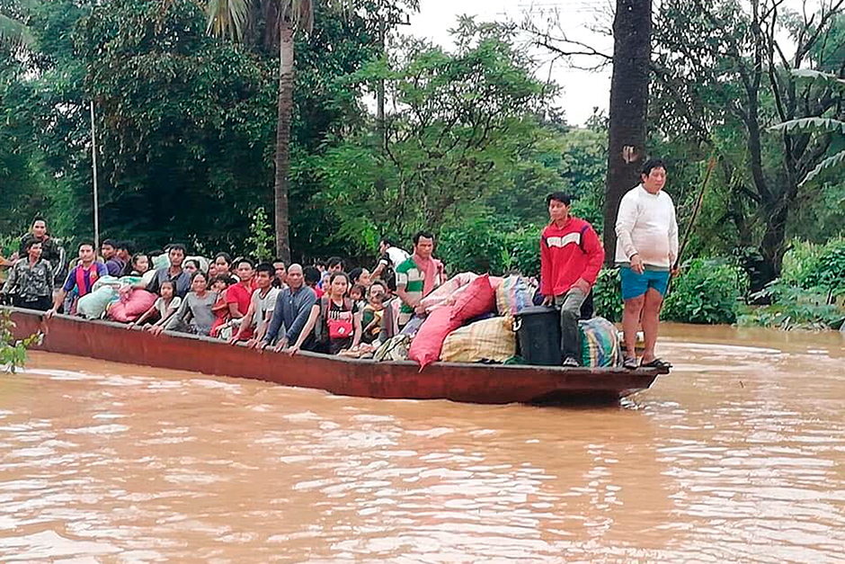 People on a boat are evacuated in the floodwaters from the collapsed Xe Pien-Xe Nammoy dam in Sanamxay district, Attapeu province, on Tuesday.