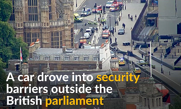 Police arrest man on terrorism charges as car hits UK parliament barriers