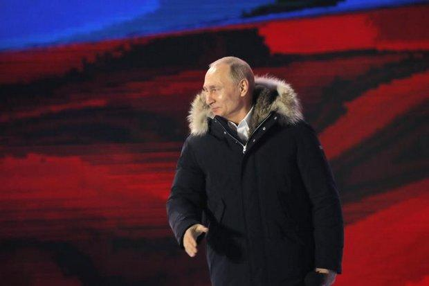 Russia's President Vladimir Putin delivers a speech during a rally in his support near Kremlin in Moscow on March 18