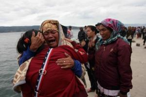 Rescuers battle waves after Indonesia ferry sinks, 128 missing