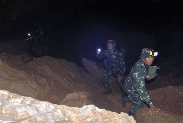 Families await news of teenage soccer team trapped in Thai cave
