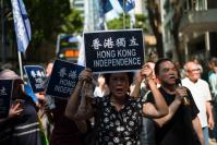 Hundreds protest threat to ban HK party