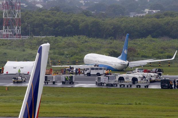 Plane skids off Manila runway, engine, wheel ripped off