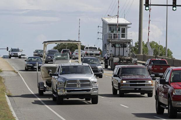 People drive over a drawbridge in Wrightsville Beach North Carolina as they evacuate the area on Tuesday in advance of Hurricane Florence