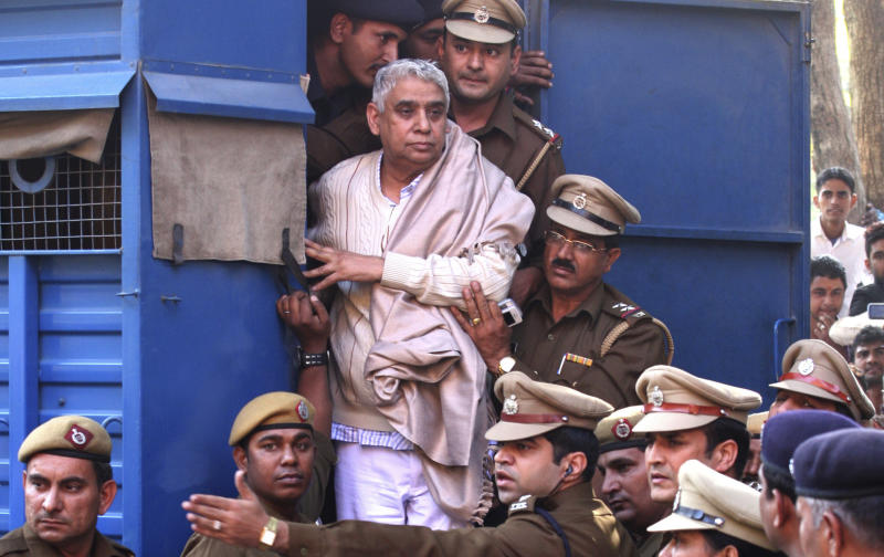 Indian court gives life sentence to guru, 14 followers
