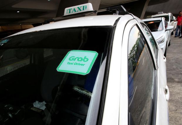 Philippines fines Grab, Uber for rushed merger, worse service