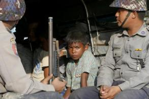 Myanmar police shoot, injure 4 in raid on Rohingya camp