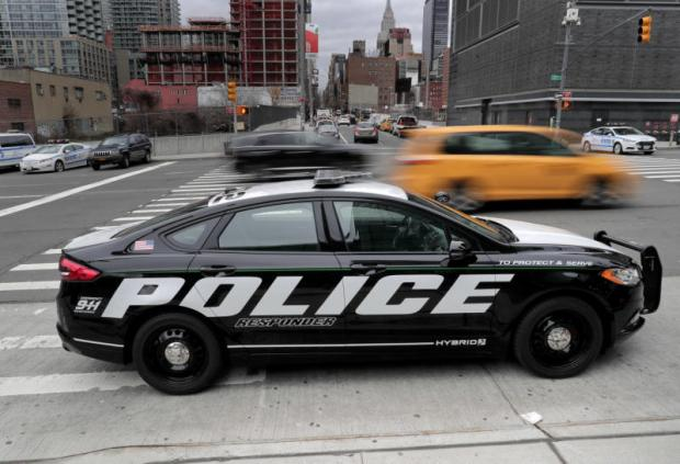 Ford reveals first hybrid police car