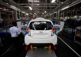 GM to cut operations in India and South Africa