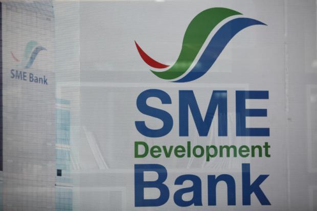 Apisak cools talk of state bank mergers