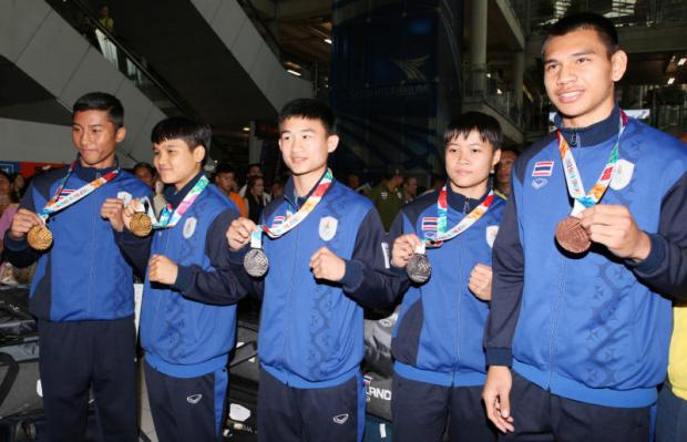 Thai heroes back with happy smiles