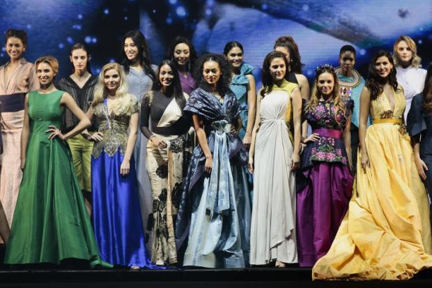 4031044eafc iconic fabric  Former Miss Universe competitors flaunt outfits made of Thai  silk at the 8th Celebration of Silk and the 1st International Thai Silk  Fashion ...
