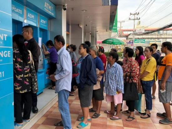 Welfare handout half depleted in 3 days | Bangkok Post: business