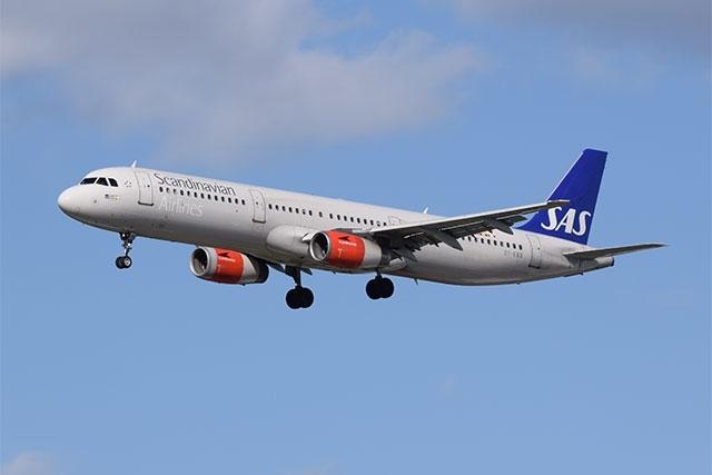 Tail fin of a SAS (Scandinavian Airways) aircraft showing the logo ...